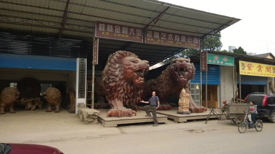 What do you do with giant tree roots? Carve them into lions for your veranda of course