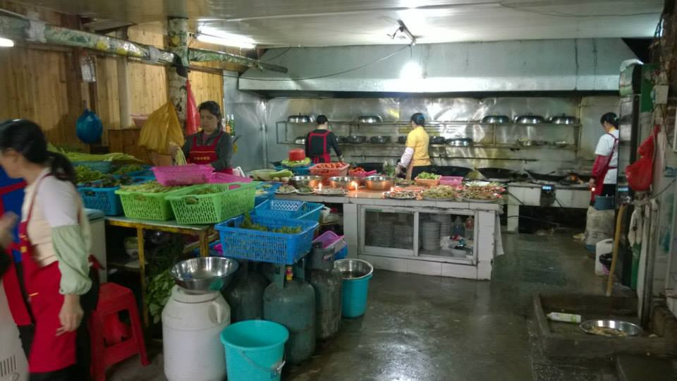 The kitchen is getting ready for our order to be cooked in YangShuo, Guangxi Province, China